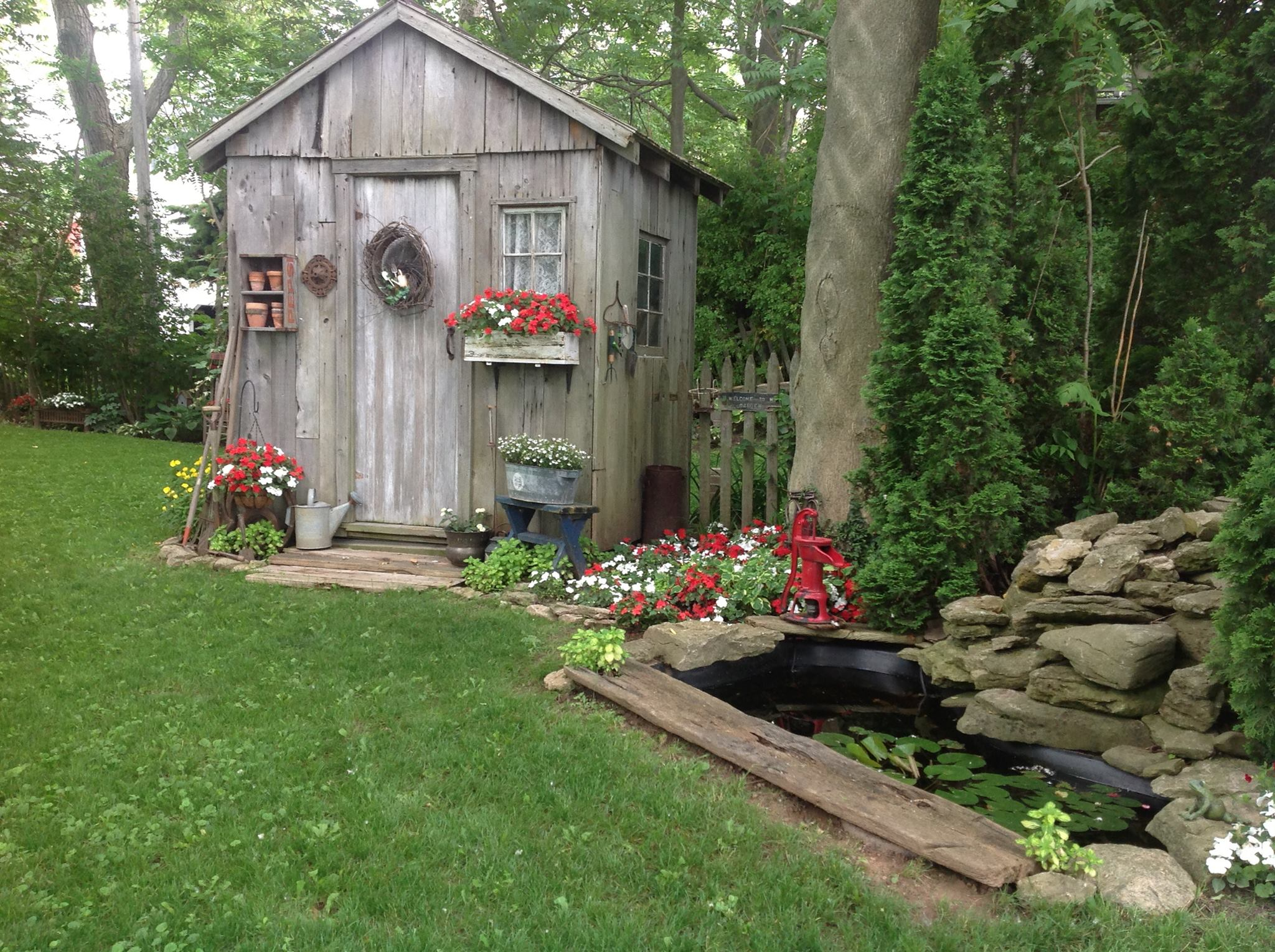 Rustic-garden-shed-softened-by-the-blooming-florals-
